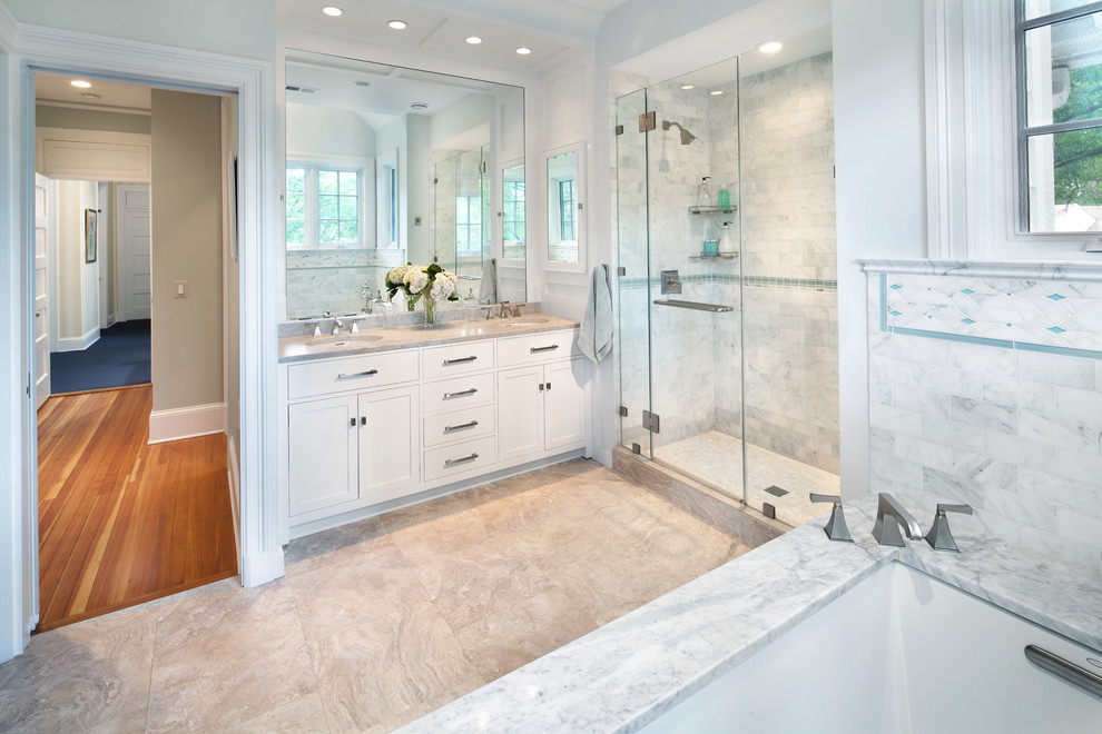 Bathroom - transitional marble tile bathroom idea in DC Metro with marble countertops
