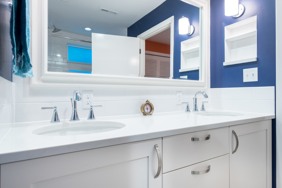 Example of a mid-sized classic master white tile and ceramic tile porcelain tile bathroom design in Portland with recessed-panel cabinets, white cabinets, a two-piece toilet, blue walls, an undermount sink and quartz countertops