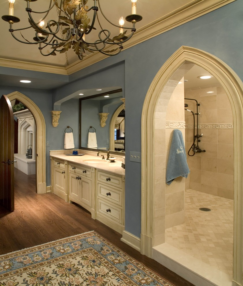 Inspiration for a timeless beige tile bathroom remodel in Columbus with an undermount sink, recessed-panel cabinets and beige cabinets