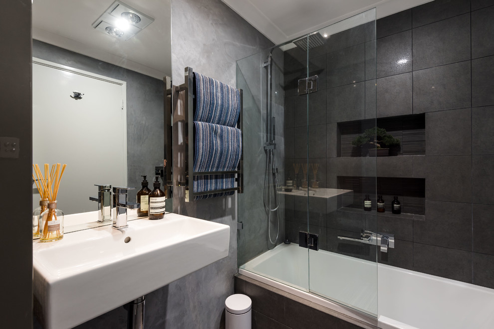 Design ideas for a contemporary bathroom in Perth with an alcove tub, a shower/bathtub combo, black tile, black walls and a wall-mount sink.