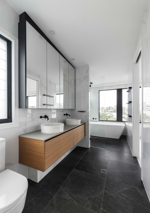black floor tiles in contemporary renovated bathroom