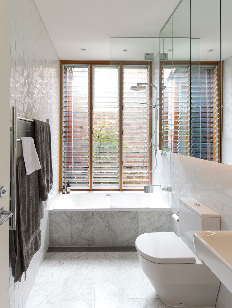 Inspiration for a mid-sized contemporary stone tile and white tile bathroom remodel in Sydney with a two-piece toilet