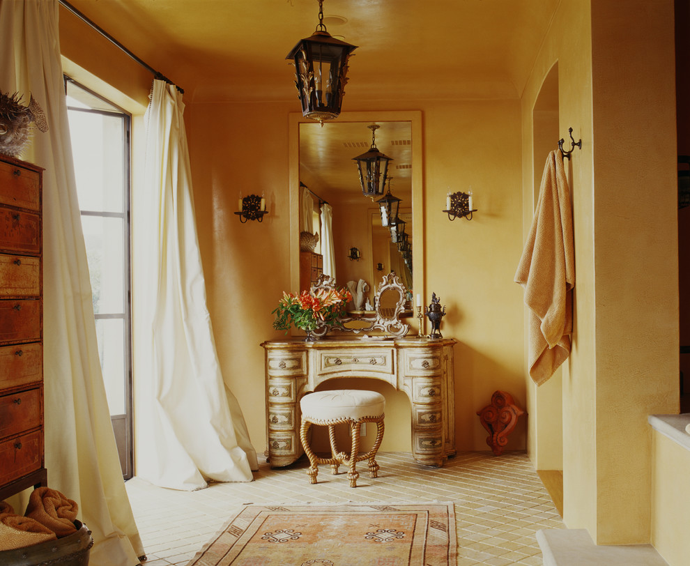 Inspiration for a mediterranean bathroom remodel in San Francisco with furniture-like cabinets and distressed cabinets