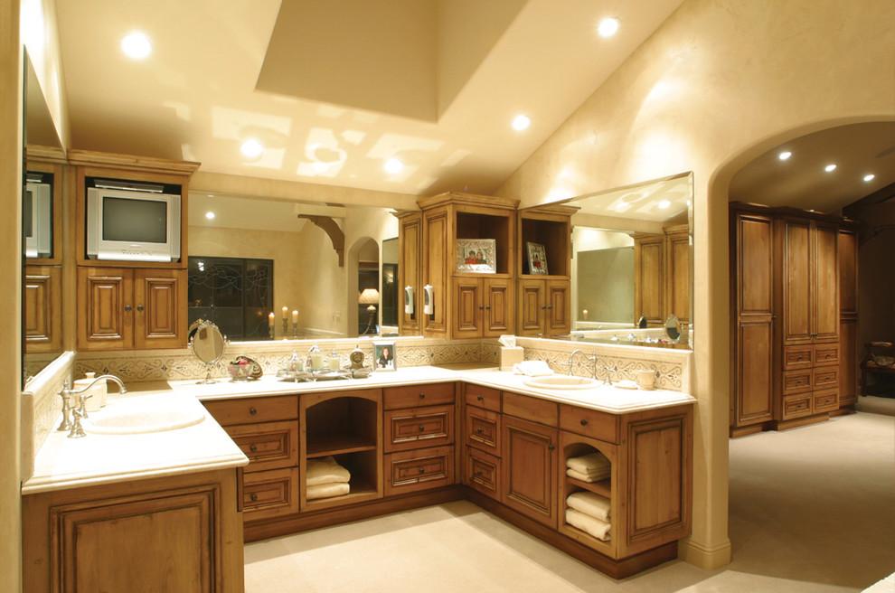 Bathroom - mediterranean bathroom idea in Los Angeles with medium tone wood cabinets and raised-panel cabinets