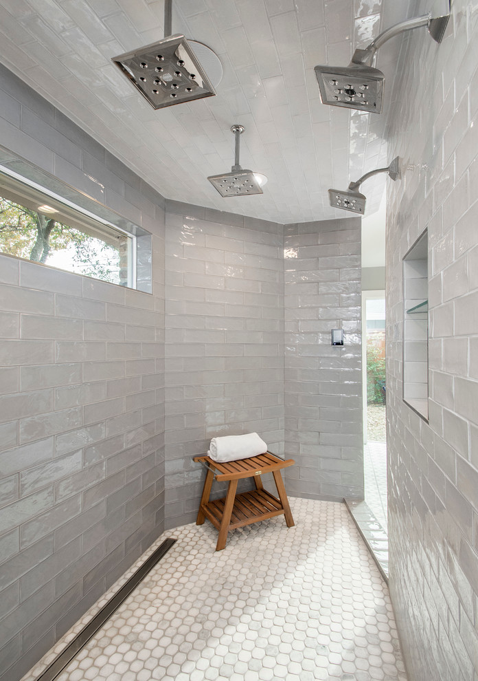 Bathroom - large transitional master gray tile and cement tile mosaic tile floor bathroom idea in Dallas with light wood cabinets, gray walls and quartzite countertops
