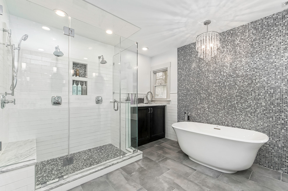 Bathroom - transitional master black and white tile, gray tile and mosaic tile gray floor and porcelain tile bathroom idea in Columbus with recessed-panel cabinets, black cabinets, white walls, a hinged shower door and a niche