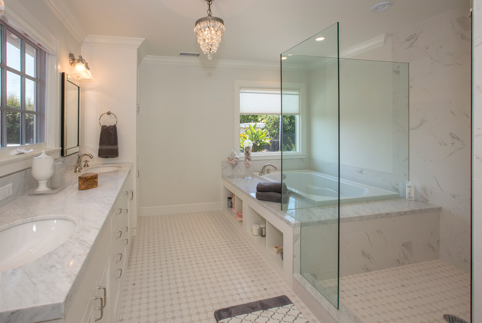 Inspiration for a transitional bathroom in Santa Barbara with white cabinets, a drop-in tub, a corner shower, white tile, white walls and an undermount sink.