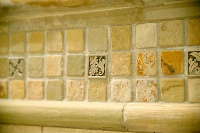 Metal tile accent in backsplash mediterranean-bathroom