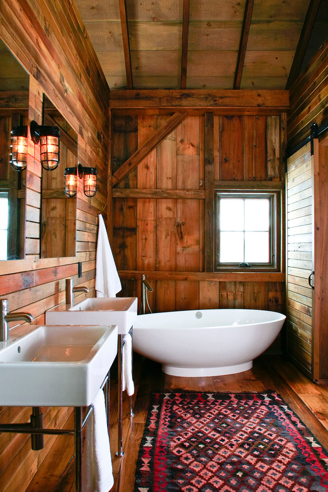 Inspiration for a rustic freestanding bathtub remodel in Detroit with a console sink