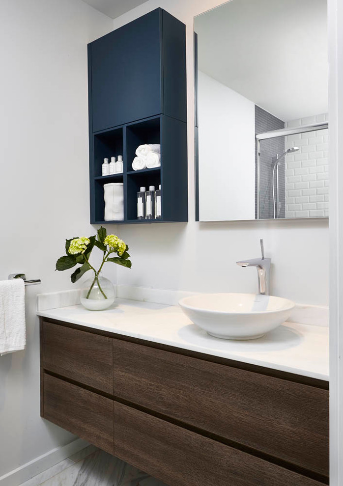 Inspiration for a small contemporary marble floor bathroom remodel in Detroit with a vessel sink, flat-panel cabinets, dark wood cabinets, quartz countertops and white walls