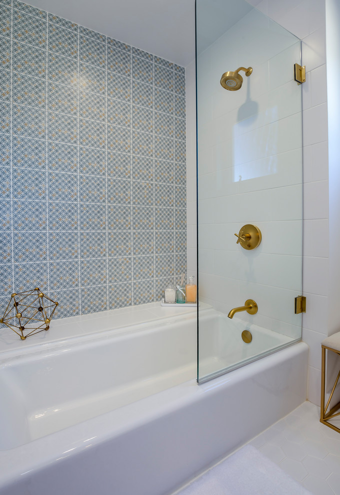 Inspiration for a mid-sized 1950s white tile and ceramic tile porcelain tile and white floor bathroom remodel in Los Angeles with medium tone wood cabinets, white walls, quartz countertops, furniture-like cabinets, a two-piece toilet, an undermount sink and a hinged shower door