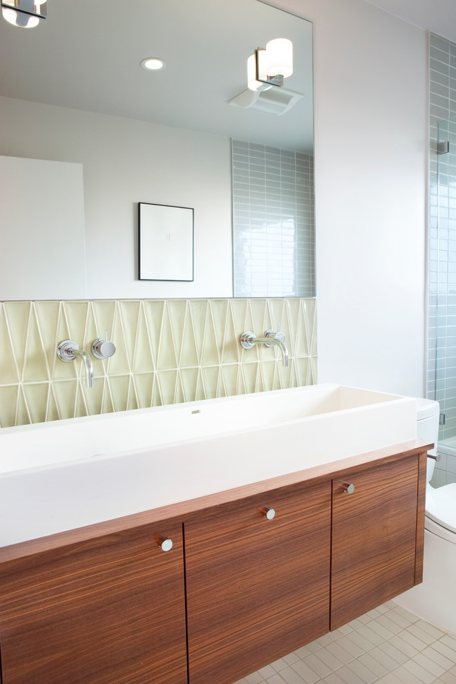 Minimalist bathroom photo in San Francisco with a trough sink and flat-panel cabinets