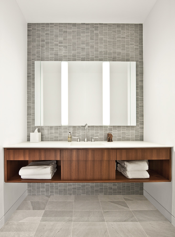 Example of an urban gray tile bathroom design in Chicago with open cabinets and dark wood cabinets