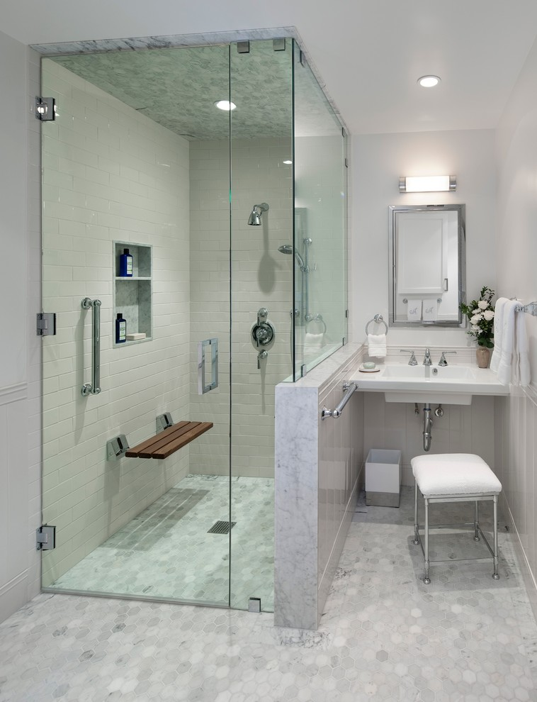Bathroom - mid-sized transitional master white tile and subway tile mosaic tile floor and gray floor bathroom idea in Los Angeles with a wall-mount sink, gray walls, a hinged shower door and a niche