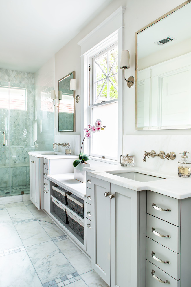 Alcove shower - transitional white floor alcove shower idea in Atlanta with recessed-panel cabinets, gray cabinets, beige walls, an undermount sink and white countertops
