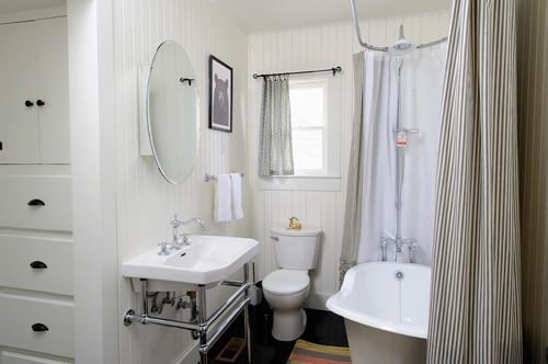 tiny bathroom with a bathtub shower