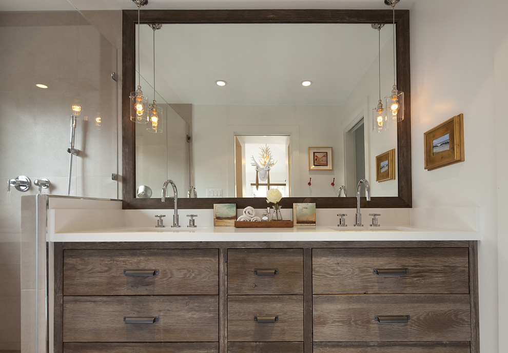 Mountain style beige tile bathroom photo in San Francisco with an undermount sink, flat-panel cabinets and dark wood cabinets