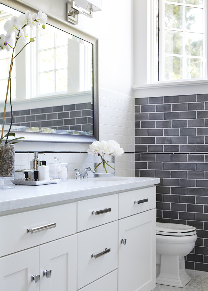 Inspiration for a transitional gray tile and subway tile bathroom remodel in San Francisco with shaker cabinets, white cabinets, an undermount sink and marble countertops