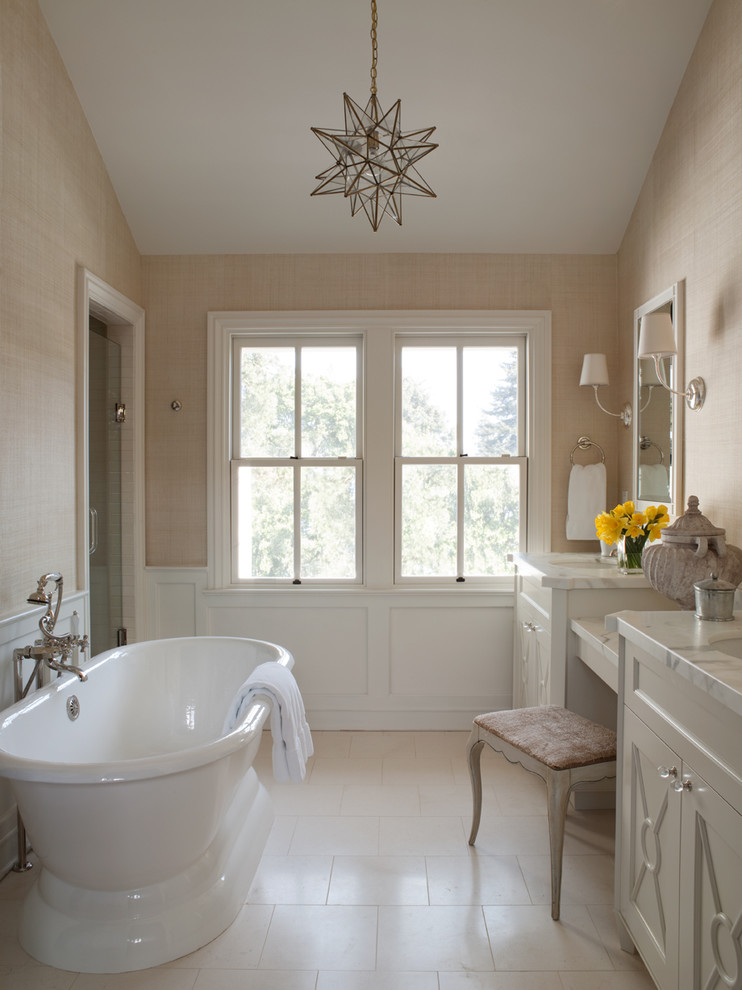 Elegant bathroom photo in San Francisco with marble countertops