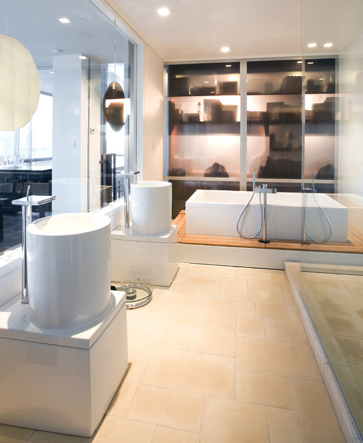 Inspiration for a contemporary beige tile and stone tile freestanding bathtub remodel in Seattle with a pedestal sink and white cabinets