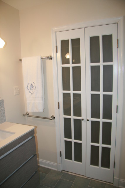 Mini french doors with frosted glass add euorpean flair - Bathroom vanity with frosted glass doors ...