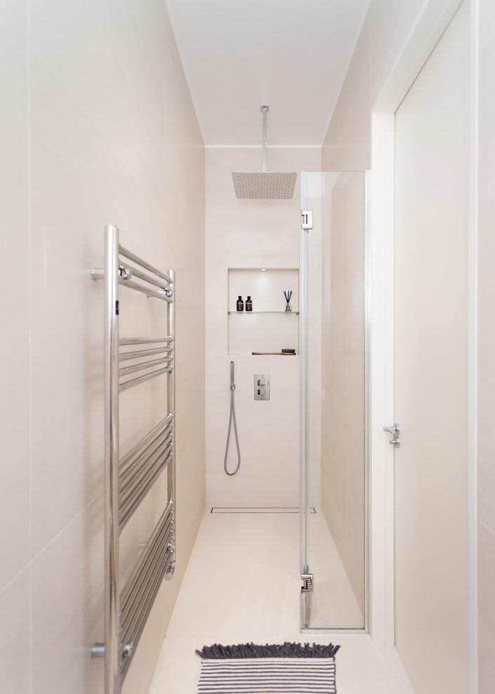 Small trendy beige tile beige floor walk-in shower photo in London with beige walls and a hinged shower door