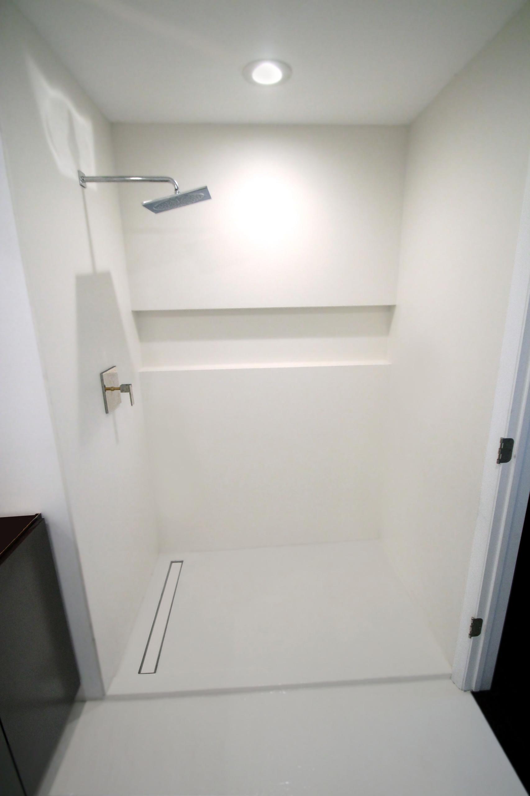 Minimalist White Bathroom - Neolith XL Porcelain tile slab/panel shower w niche