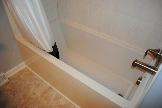 Mirabelle Soaker Tub, Vinyl Floor, Porcelain Tile Traditional Bathroom