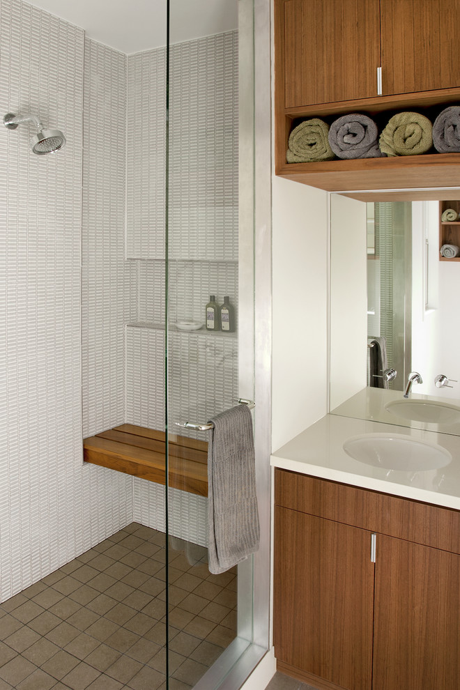 Inspiration for a modern white tile alcove shower remodel in San Francisco with an undermount sink, flat-panel cabinets and medium tone wood cabinets