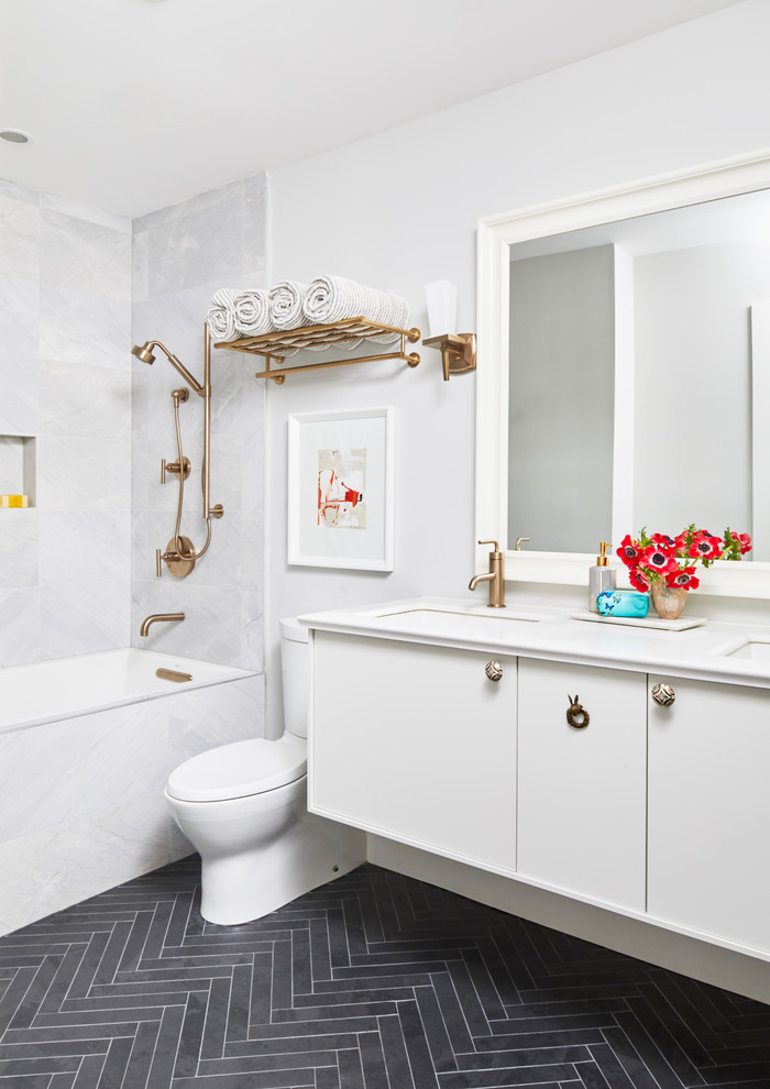 Transitional gray tile black floor bathroom photo in Toronto with flat-panel cabinets, white cabinets, white walls, an undermount sink and white countertops