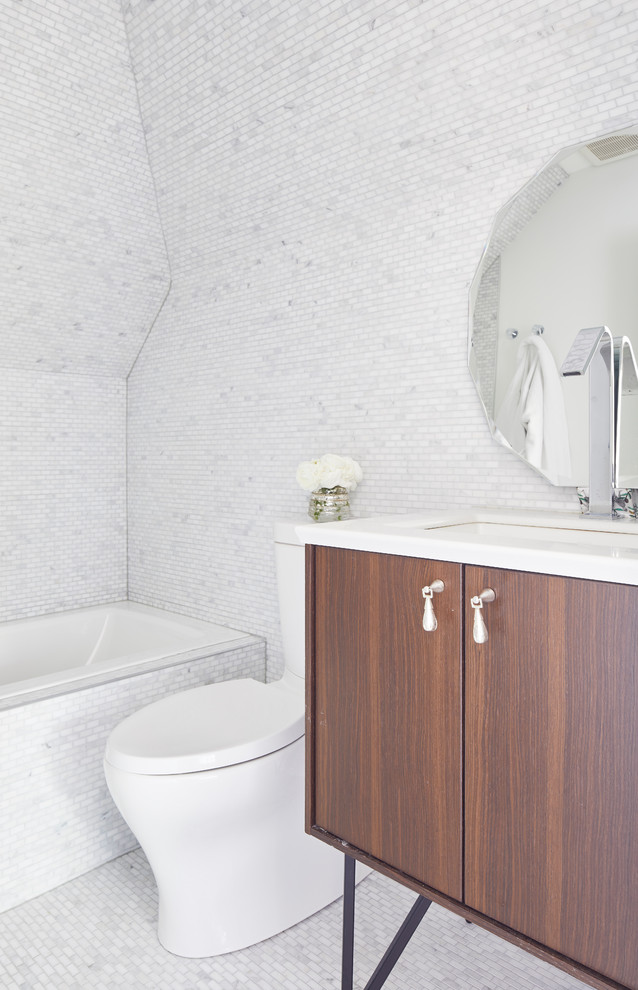 Inspiration for a transitional white tile and mosaic tile mosaic tile floor and white floor alcove bathtub remodel in Toronto with furniture-like cabinets, dark wood cabinets, an undermount sink and white countertops