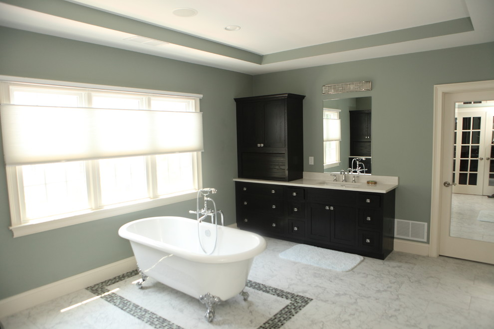 Inspiration for a modern multicolored tile and glass tile marble floor freestanding bathtub remodel in Providence with flat-panel cabinets, black cabinets, green walls, an undermount sink and granite countertops