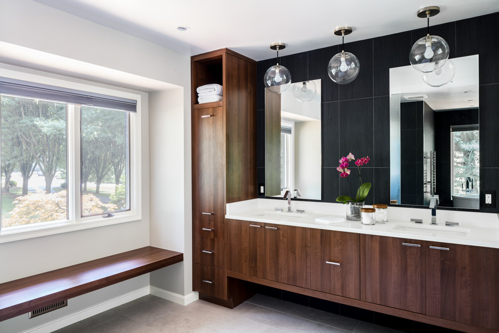 Bathroom - large contemporary master black tile and porcelain tile gray floor and porcelain tile bathroom idea in DC Metro with flat-panel cabinets, dark wood cabinets, gray walls, an undermount sink, a one-piece toilet and solid surface countertops
