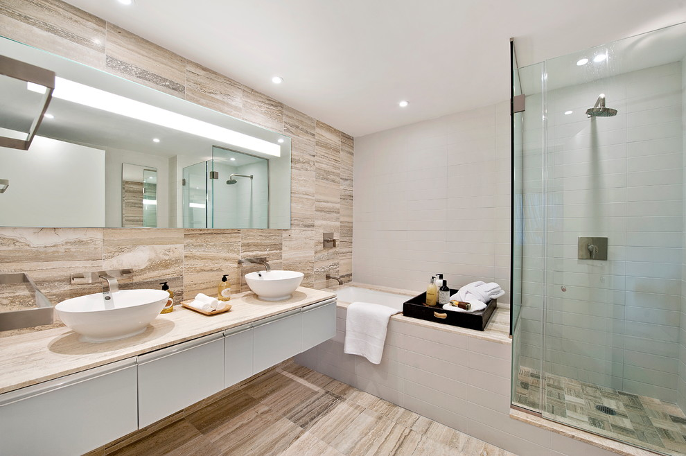 Example of a minimalist stone tile bathroom design in New York with a vessel sink