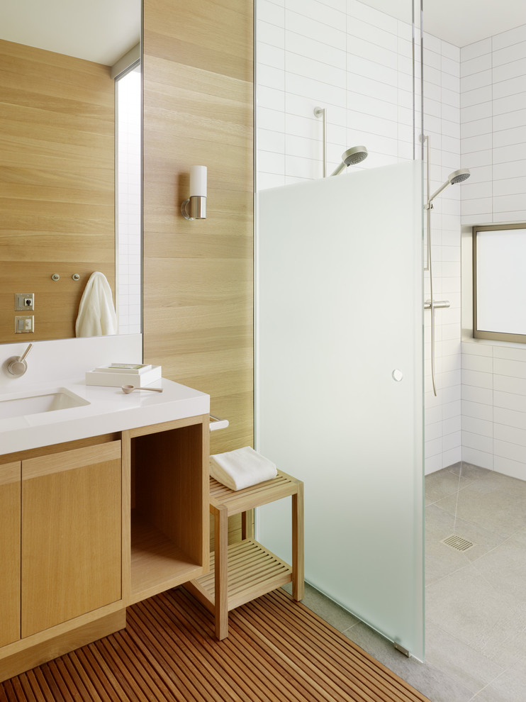 Danish white tile concrete floor double shower photo in San Francisco with an undermount sink, flat-panel cabinets and medium tone wood cabinets