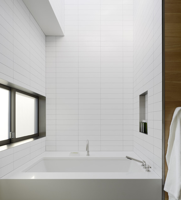 Inspiration for a modern white tile bathroom remodel in San Francisco with an undermount tub