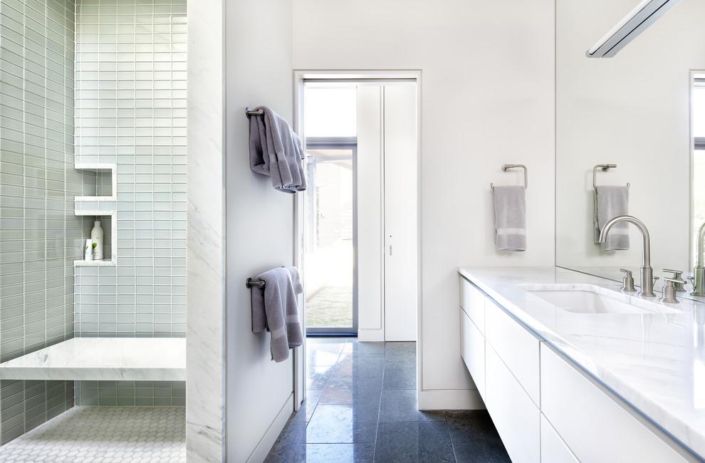 Example of a minimalist glass tile bathroom design in Austin