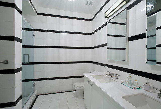 Minimalist black and white tile alcove shower photo in New York with an undermount sink, flat-panel cabinets and white cabinets