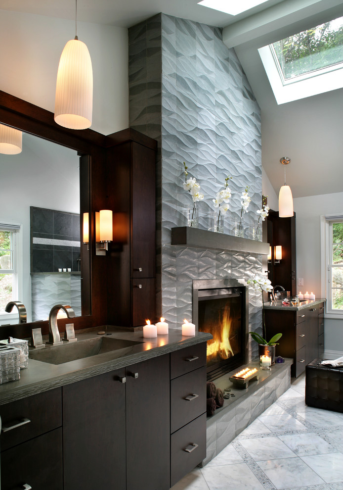 Bathroom - mid-sized contemporary gray tile and porcelain tile bathroom idea in New York with flat-panel cabinets, concrete countertops, a one-piece toilet, an integrated sink, dark wood cabinets, white walls and gray countertops