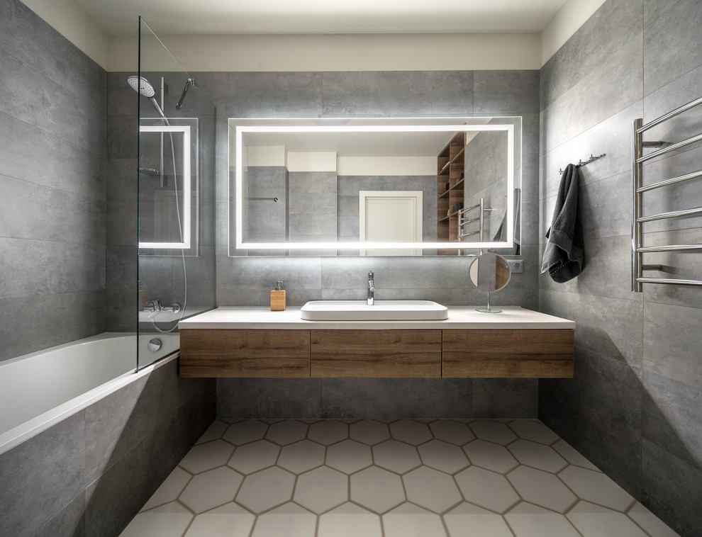 Mid-sized trendy 3/4 gray tile white floor bathroom photo in San Francisco with flat-panel cabinets, medium tone wood cabinets, white walls, a vessel sink and white countertops