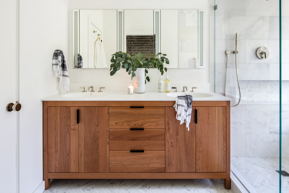 Bathroom - mid-sized transitional master white tile and stone tile marble floor and white floor bathroom idea in San Francisco with furniture-like cabinets, medium tone wood cabinets, white walls, an integrated sink, quartz countertops and white countertops