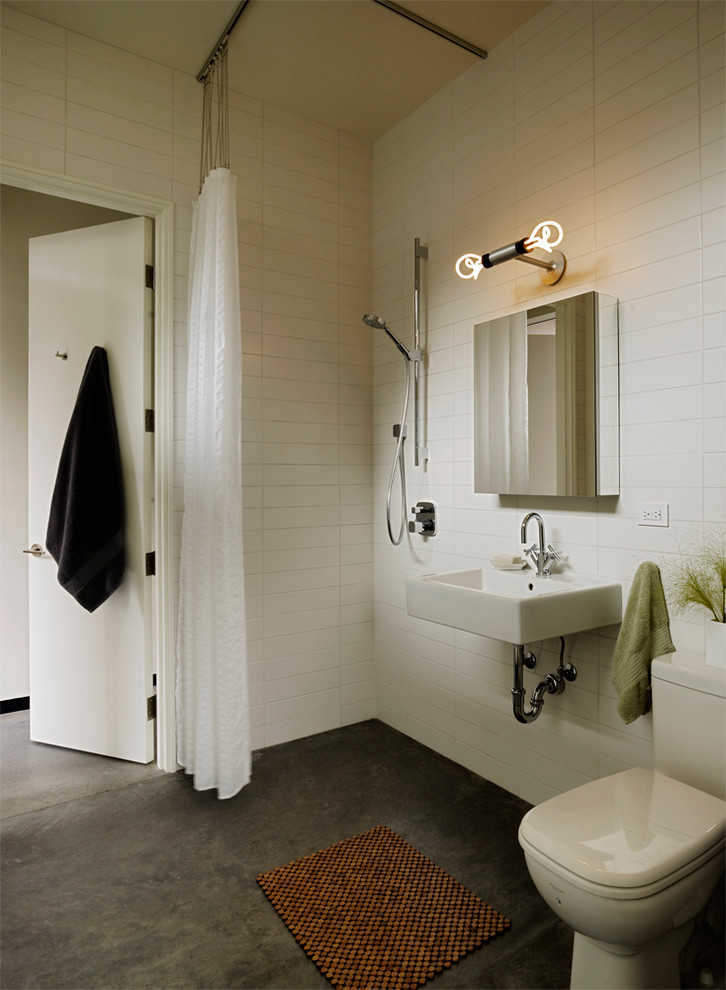 Inspiration for a modern concrete floor walk-in shower remodel in San Francisco with a vessel sink