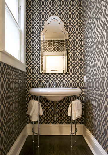 Example of a small trendy 3/4 dark wood floor bathroom design in San Francisco with gray walls and a console sink