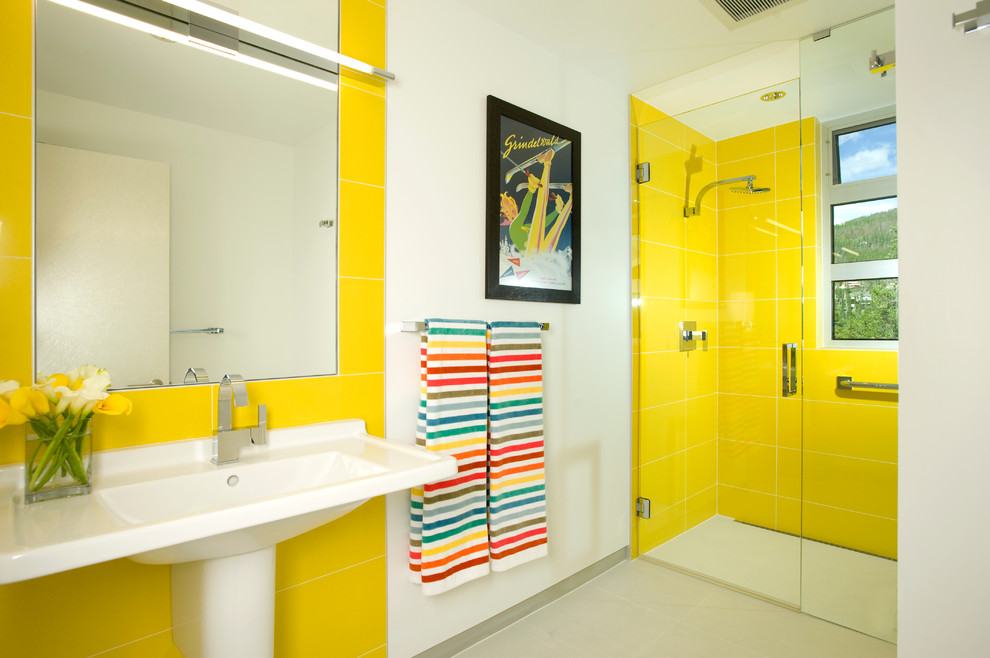 Example of a minimalist kids' yellow tile bathroom design in Denver with a pedestal sink