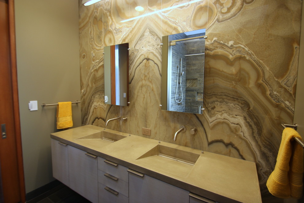 Inspiration for a mid-sized modern master beige tile and stone slab bathroom remodel in San Francisco with flat-panel cabinets, white cabinets, a one-piece toilet, beige walls, an integrated sink and engineered quartz countertops