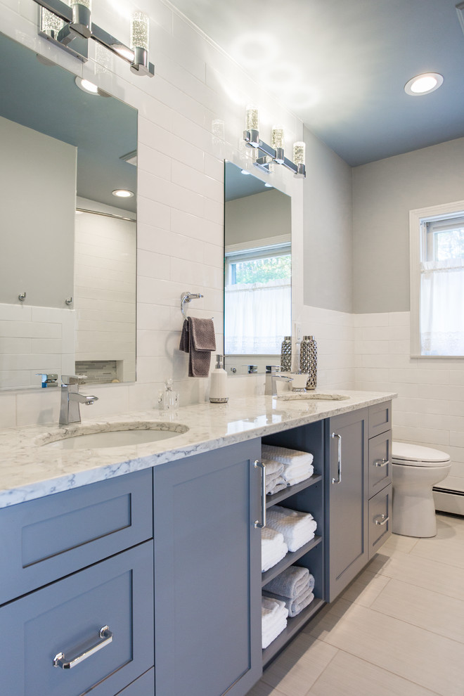 Mid-sized transitional white tile and ceramic tile porcelain tile bathroom photo in Boston with an undermount sink, gray cabinets, quartz countertops, gray walls and shaker cabinets