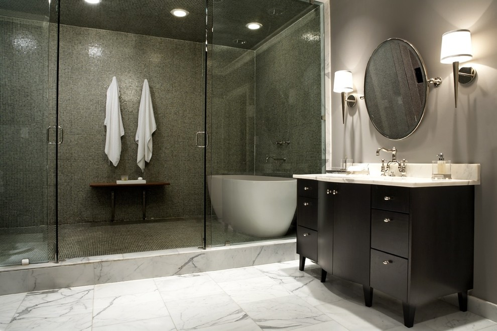 Bathroom - large contemporary white tile and mosaic tile marble floor and white floor bathroom idea in Seattle with an integrated sink, furniture-like cabinets, dark wood cabinets, marble countertops, a one-piece toilet, gray walls, a hinged shower door and white countertops