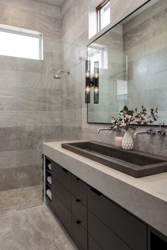 Example of a mid-sized minimalist master gray tile gray floor bathroom design in Miami with flat-panel cabinets, black cabinets, a trough sink, gray countertops and gray walls