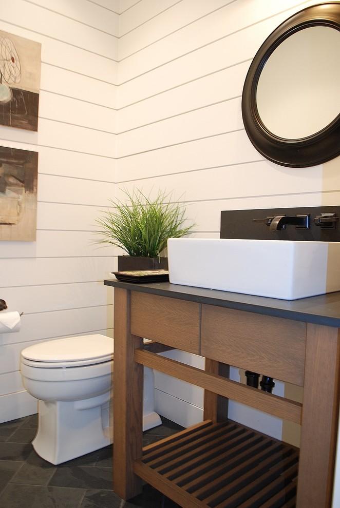 Bathroom - farmhouse bathroom idea in Boise with a vessel sink