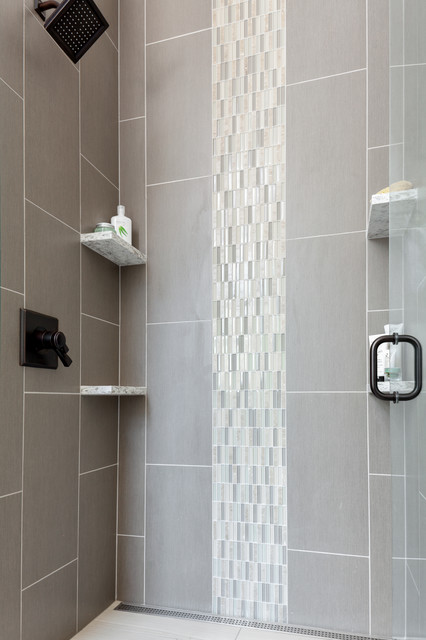 Inspiration for a mid-sized transitional 3/4 subway tile and gray tile alcove shower remodel in Seattle with shaker cabinets, white cabinets, a two-piece toilet, gray walls, an undermount sink, quartzite countertops and a hinged shower door